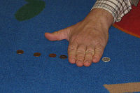 hand covering coins
